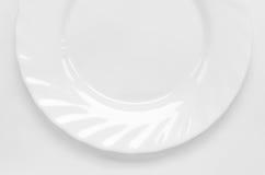 White dish. Shiny white dish closeup on white background Royalty Free Stock Photos