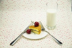 White dishes, cakes, cherries, cutlery, knives and forks, milk Stock Photography