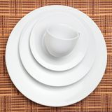 White Dishes and a Cup Stock Image