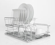 White dishes drying on metal dish rack Stock Images