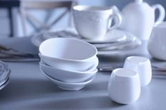 White dishes on table. White dishes on grey table Stock Image