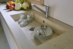 White dishes in the marble sink Stock Photography