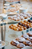 White dishes and pastries Royalty Free Stock Photos