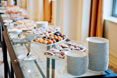 White dishes and pastries Royalty Free Stock Photography