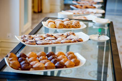 White dishes and pastries Stock Photos