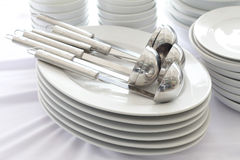 White dishes ,spoon and bowl Stock Photo
