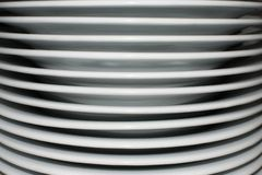 White dishes. Stacked in the kitchen, crockery Royalty Free Stock Photography