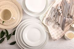 White dishes on table. White dishes on wooden table Stock Photo