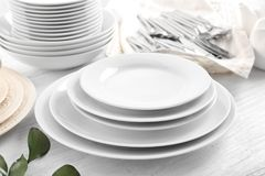 White dishes on   table. White dishes on wooden table Stock Photography