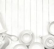 White dishes. On a white wooden background Royalty Free Stock Photography