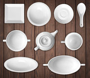 White dishes. On a wooden background Stock Image