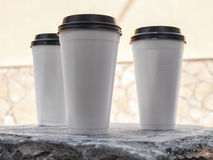 White disposable cups with black lids stock image
