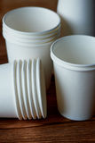 White disposable paper cups for coffee and tea.A lot. Royalty Free Stock Photos