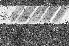 White dividung line fragment, tire tracks Royalty Free Stock Photography