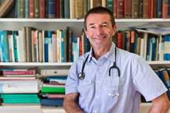 White Doctor In Front Of Books Stock Photography