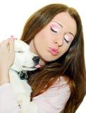 White dog . Young, beautiful girl hugging white dog closing his eyes stock image