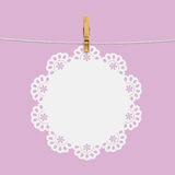White doily hanging on rope with wooden clothespin. For text or photo, graphic, advertisment Royalty Free Stock Photos