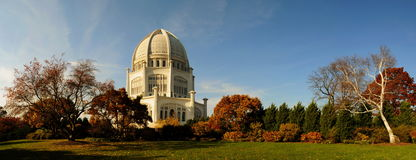Landscape and white dome building. White dome building on a grassy campus with Fall foliage royalty free stock photos