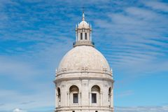 White dome of an historic church against a blue sky in the Alfama District of Lisbon, Portugal stock images
