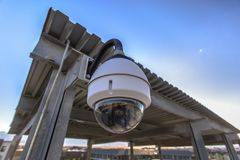 White dome security camera in business lot stock image