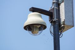White dome security camera at pole . Focus selective stock photo