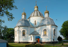 White domed church. A 400 year old white domed church topped with crosses in Novovolynsk, Volyn, Ukraine Royalty Free Stock Images