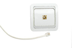 White domestic telephone socket and part of corresponding teleph Stock Image
