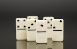 White dominoes showing leader or winner Stock Photography