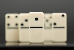 White dominoes showing leader or winner Royalty Free Stock Photo