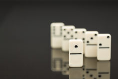 White dominoes showing leader or winner Royalty Free Stock Images