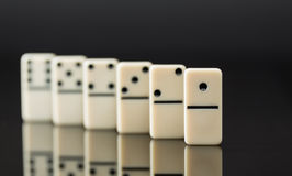 White dominoes showing leader or winner Royalty Free Stock Image