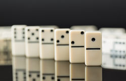 White dominoes showing leader or winner Stock Images