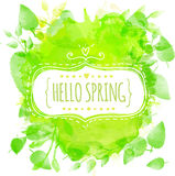 White doodle decorative frame with text hello spring. Green watercolor splash background with printed leaves. Artistic  desi Stock Photo