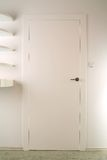 White Door. In a white room. Could be a closet or entry to a home or room royalty free stock photo