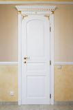 White door. With an ornament in a modern apartment Royalty Free Stock Photography