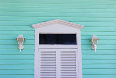 White Door with Aqua Siding Stock Image