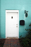 White Door and Blue Brick Wall Royalty Free Stock Images