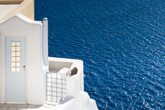The White door and the blue sea Royalty Free Stock Images