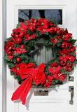 White door with Christmas decorations Royalty Free Stock Image