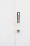 White door close with steel handle and key. Royalty Free Stock Photography
