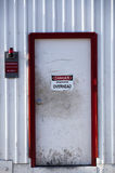 White Door with Danger Sign Royalty Free Stock Photos