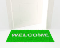 The white door and green rug. Royalty Free Stock Photos