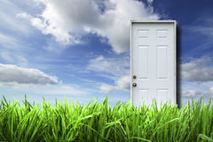 White door isolated in spring landscape Stock Photos