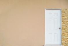 White door. On with the light orange wall royalty free illustration