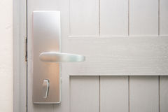 White the door with metal handle Royalty Free Stock Photos
