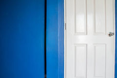 White door and navy blue wall Stock Photos