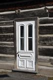 White door on an old wooden houses Royalty Free Stock Photography