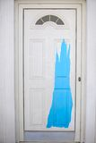 White door painted with blue paint in greek Stock Photos