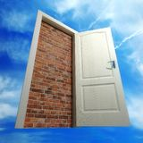 White door put by a bricklaying against the sky. (3d rendering Royalty Free Stock Photography
