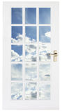 White door with sky behind Royalty Free Stock Image